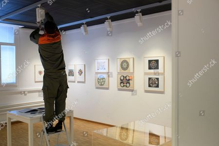 An employee sets up the exhibtion 'In the Land of Imagination - The C.G. Jung Collection', in St. Gallen, Switzerland, 20 March 2018 (issued 23 March). The collection of Swiss psychiatrist Carl Gustav Jung will be on display for the first time from 27 March to 08 July. Jung asked his patients to draw their 'inner images' during the years 1917 to 1955.