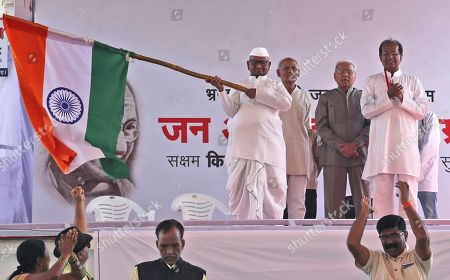Social activist Anna Hazare waves the Indian national flag during the start of his indefinite hunger strike in New Delhi, India, . Hazare is demanding setting up of a Lokpal, or independent ombudsman to investigate and prosecute cases of corruption, besides implementation of the Swaminathan Commission report which has suggested ways to address difficulties faced by the farming community