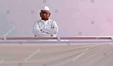 Social activist Anna Hazare listens to a speaker during the start of his indefinite hunger strike in New Delhi, India, . Hazare is demanding setting up of a Lokpal, or independent ombudsman to investigate and prosecute cases of corruption, besides implementation of the Swaminathan Commission report which has suggested ways to address difficulties faced by the farming community