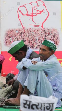 Indian farmers listen to a speaker during the start of an indefinite hunger strike by social activist Anna Hazare in New Delhi, India, . Hazare is demanding setting up of a Lokpal, or independent ombudsman to investigate and prosecute cases of corruption, besides implementation of the Swaminathan Commission report which has suggested ways to address difficulties faced by the farming community