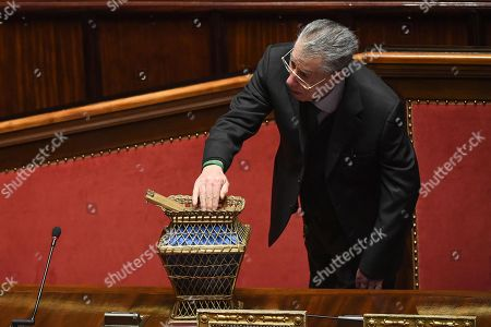 Umberto Bossi, former leader of the Lega Nord, casts his ballot to elect the Speaker of the Italian Senate during the first session of the XVIII legislature in the Senate chamber, in Rome, Italy, 23 March 2018. The XIII Legislature starts following the Italian general election from 04 March 2018.
