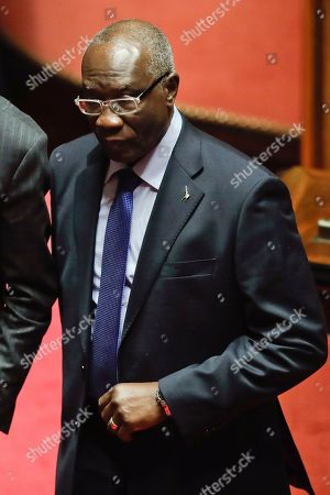 The League party' senator Tony Iwobi walks to the ballots booth during the vote to elect Senate's president, in Rome, . Italian lawmakers have formally reconvened parliament following inconclusive March 4 elections without any accord in sight as to the formation of a new government