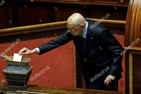 Former Italian president Giorgio Napolitano casts his ballot during the vote to elect Senate's president, in Rome, . Italian lawmakers have formally reconvened parliament following inconclusive March 4 elections without any accord in sight as to the formation of a new government