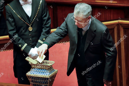 Umberto Bossi casts his ballot during the vote to elect Senate's president, in Rome, . Italian lawmakers have formally reconvened parliament following inconclusive March 4 elections without any accord in sight as to the formation of a new government