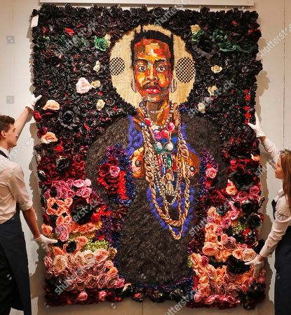 Sotheby's employees adjust the artwork 'The Exile According to the Elder' by Athi-Patra Ruga in London, . The artwork, estimated 20,000 - 30,000GBP (28,000-42,000USD) is part of a Modern and Contemporary African Art Sale at the auction house Sotheby's