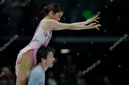 Kana Muramoto and Chris Reed of Japan perform during pairs Ice dance at the Figure Skating World Championships in Assago, near Milan