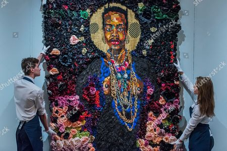 The Exile According to the Elder (2014,, est. £20,000-30,000) an intricate self-portrait in tapestry by Athi-Patra, Ruga