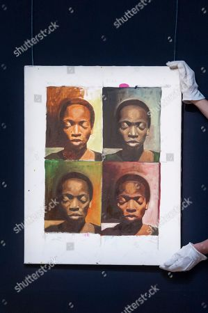"A technician hangs ""A La Warhol"", by Njideka Akunyili Crosby (Est. GBP50,000-70000)"