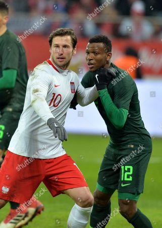 Grzegorz Krychowiak of Poland and Abdullahi Shehu of Nigeria