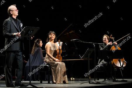 Bill Murray, pianist Vanessa Perez, violinist Mira Wang, and cellist Jan Vogler perform onstage