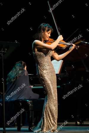 Violinist Mira Wang performs onstage