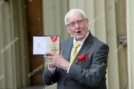 Playwright Peter Nichols receives a CBE for services to Drama at an investiture at Buckingham Palace