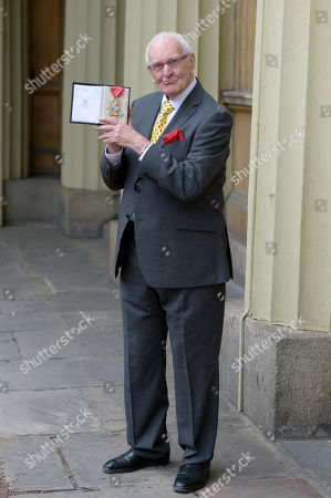 Stock Photo of Playwright Peter Nichols receives a CBE for services to Drama at an investiture at Buckingham Palace