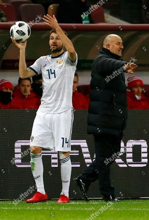 Russia's Vladimir Granat gestures next to Russia head coach Stanislav Cherchesov, right, during an international friendly soccer match between Russia and Brazil at the Luzhniki stadium in Moscow, Russia