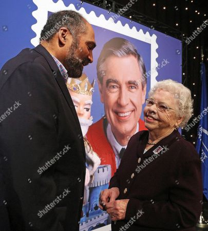 Joanne Rogers, Franco Harris. Fred Rogers wife, Mrs. Joanne Rogers, right, visits with Pittsburgh Steelers Pro Football Hall of Fame running back Franco Harris in front of a giant Mister Rogers Forever Stamp following the first-day-of-issue dedication in WQED's Fred Rogers Studio in Pittsburgh
