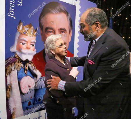 Joanne Rogers, Franco Harris. Fred Rogers wife, Mrs. Joanne Rogers, left, visits with Pittsburgh Steelers Pro Football Hall of Fame running back Franco Harris in front of a giant Mister Rogers Forever Stamp following the first-day-of-issue dedication in WQED's Fred Rogers Studio in Pittsburgh