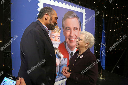Joanne Rogers, Franco Harris. Fred Rogers wife, Mrs. Joanne Rogers, right, visits with Pittsburgh Steelers Pro Football Hall of Fame running back Franco Harris in front of a poster of the Mister Rogers Forever Stamp following the first-day-of-issue dedication in WQED's Fred Rogers Studio in Pittsburgh
