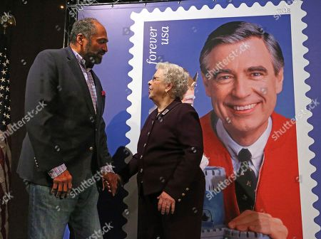 Joanne Rogers, Franco Harris. Fred Rogers wife, Mrs. Joanne Rogers, center, visits with Pittsburgh Steelers Pro Football Hall of Fame running back Franco Harris in front of a poster of the Mister Rogers Forever Stamp following the first-day-of-issue dedication in WQED's Fred Rogers Studio in Pittsburgh