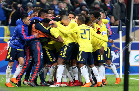 Juan Fernando Quintero of Colombia celebrates scoring his sides third goal with team mates.