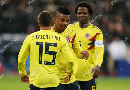Frank Fabra of Colombia shakes hands with Juan Fernando Quintero at full time.