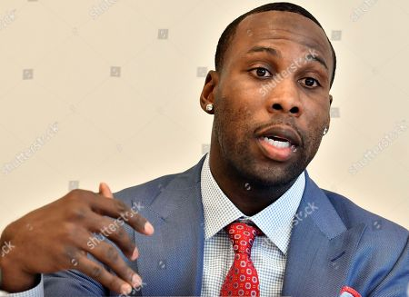 Former NFL player Anquan Boldin, speaks during a session to discuss criminal justice issues with other current and former NFL football players at Harvard Law School, in Cambridge, Mass