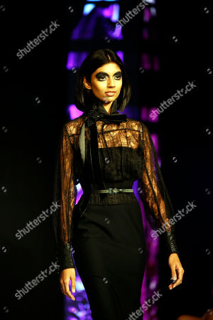 Stock Photo of A model presents a creation by French designer Eymeric Francois during the Colombo Fashion Week at Hilton Hotel in Colombo, Sri Lanka 23 March 2018. The Colombo Fashion Week runs until 25 March.