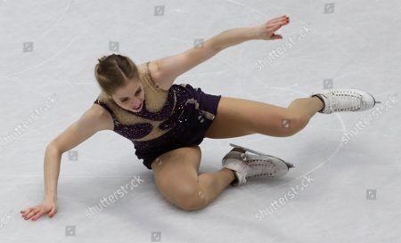 Carolina Kostner of Italy falls during the women's free skating program