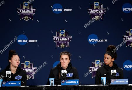 Stock Photo of Faith Suggs, Lexie Brown, Rebecca Greenwell. Duke's Faith Suggs, left, and teammate Lexie Brown, watch as Rebecca Greenwell, center, responds to a question during a news conference at the NCAA women's college basketball tournament, in Albany, N.Y. Duke face Connecticut in a regional semifinal on Saturday