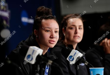 Duke's Faith Suggs, left, responds to a question to a question during a news conference at the NCAA women's college basketball tournament, in Albany, N.Y. Duke face Connecticut in a regional semifinal on Saturday