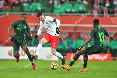 Robert Lewandowski of Poland (C) in action against Brian Idowu (L) and Wilfred Ndidi (R) of Nigeria during the international friendly soccer match between Poland and Nigeria in Wroclaw, Poland, 23 March 2018.