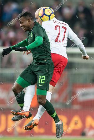 Rafal Kurzawa (R) of Poland in action against Abdullahi Shehu (L) of Nigeria during the international friendly soccer match between Poland and Nigeria in Wroclaw, Poland, 23 March 2018.
