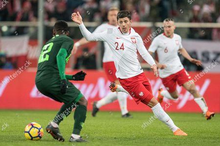 Dawid Kownacki (R) of Poland in action against Abdullahi Shehu (L) of Nigeria during the international friendly soccer match between Poland and Nigeria in Wroclaw, Poland, 23 March 2018.