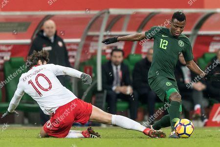 Grzegorz Krychowiak (L) of Poland in action against Abdullahi Shehu (R) of Nigeria during the international friendly soccer match between Poland and Nigeria in Wroclaw, Poland, 23 March 2018.