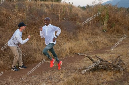 Stock Picture of Photo exclusive: Gary Lough (UK) is the new coach for Mo Farah (UK) both photographed during a training session in Sulultra near Addis Ababa in Ethiopia.