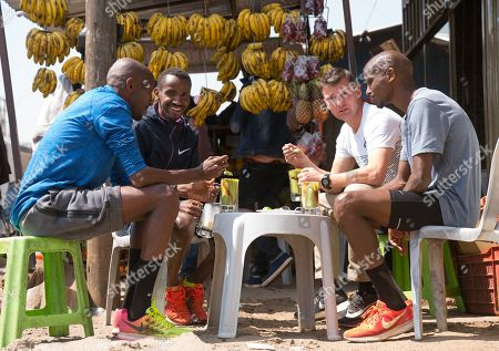 Photo exclusive: Mo Farah (UK) in sun glasses having a fruit juice with Gary Lough (UK) his new coach and training partners Abdi Abdirahman (USA) in blue and Bashir Abdi (BEL) in black in Sulultra near Addis Ababa in Ethiopia.