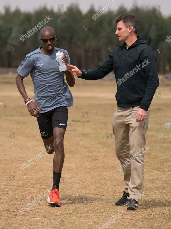 Stock Image of Gary Lough (UK) is the new coach for Mo Farah (UK) both photographed during a training session in Sulultra near Addis Ababa in Ethiopia.