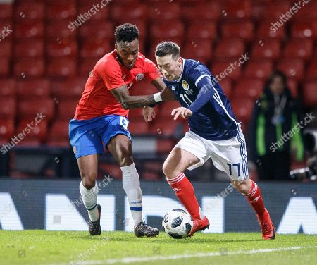 Rodney Wallace of Costa Rica (L) in action with Callum McGregor of Scotland (R) during the Scotland v Costa Rica. Vauxhall International Challenge Match Hampden Park, Scotland, Britain, 23 March 2018.