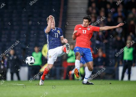 Matt Ritchie of Scotland (L) in action with Yeltsin Tejeda of Costa Rica (R) during the Scotland v Costa Rica. Vauxhall International Challenge Match Hampden Park, Scotland, Britain, 23 March 2018.