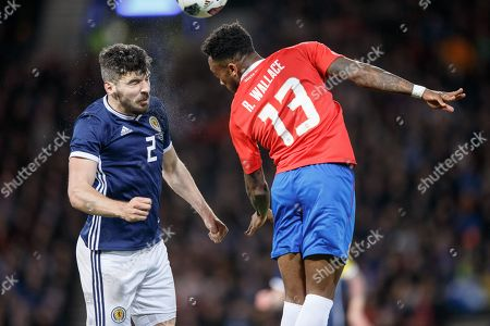 Callum Paterson of Scotland (L) in action with Rodney Wallace of Costa Rica (R) during the Scotland v Costa Rica. Vauxhall International Challenge Match Hampden Park,  Scotland, Britain, 23 March 2018.