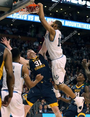 Omari Spellman, Logan Routt. Villanova's Omari Spellman, right, dunks over West Virginia's Logan Routt during the second half of an NCAA men's college basketball tournament regional semifinal, in Boston