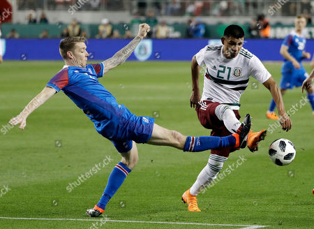 Jesus Gallardo, Birkir Saevarsson. Mexico's Jesus Gallardo, right, is defended by Iceland's Birkir Saevarsson during the first half of an international friendly soccer match, in Santa Clara, Calif