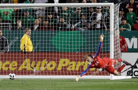 Stock Picture of Runar Runarsson, Miguel Layun. Iceland goalkeeper Runar Runarsson gives up a goal on a shot from Mexico's Miguel Layun during the second half of an international friendly soccer match, in Santa Clara, Calif