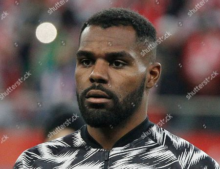 Nigeria's Brian Idowu stands for the national anthem of his country before an international friendly soccer match between Poland and Nigeria in Wroclaw, Poland