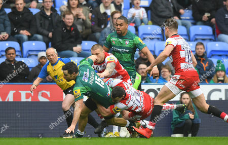 James Marshall of London Irish is held in the tackle by Tom Marshall of Gloucester Rugby during the Aviva Premiership Rugby match between London Irish and Gloucester Rugby at Madejski Stadium on March 24th 2018 in Reading, Berkshire, England. (Photo by Gareth Davies/PPAUK)