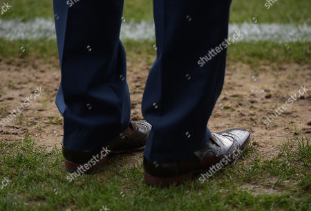 The polished brogues of Peterborough United Director of Football Barry Fry on the touchline