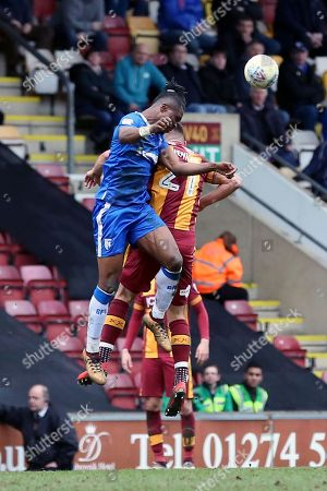 Gillingham defender Gabriel Zakuani (6) heads the ball  during the EFL Sky Bet League 1 match between Bradford City and Gillingham at the Northern Commercials Stadium, Bradford. Picture by Mick Atkins