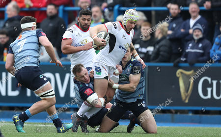 Cardiff Blues vs Ulster . Ulster's Luke Marshall is tackled by Matthew Rees of Cardiff