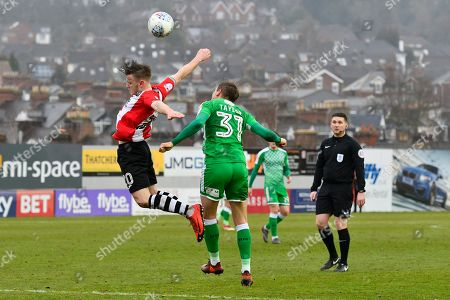 Matt Jay (20) of Exeter City battles for possession with Matthew Taylor (31) of Swindon Town during the EFL Sky Bet League 2 match between Exeter City and Swindon Town at St James' Park, Exeter. Picture by Graham Hunt