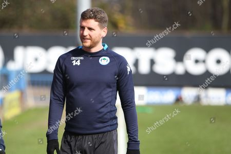 (14) Alex Bruce for Wigan Athletic during the EFL Sky Bet League 1 match between Bury and Wigan Athletic at the JD Stadium, Bury. Picture by Graham Holt