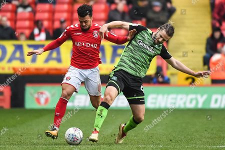 Stock Image of Charlton Athletic Forward Leon Best (8) and Plymouth Argyle Midfielder Jamie Ness (6) battle for the ball during the EFL Sky Bet League 1 match between Charlton Athletic and Plymouth Argyle at The Valley, London. Picture by Stephen Wright